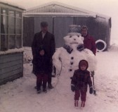 Albert and Nora Bartle with Sarah Jordan with a snowman in Pymoor 1984.