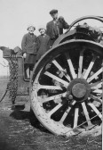 Peggy and Freda Graham with Lewis Pate on a steam engine in Pymoor.