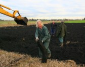 Tony Rudderham moves a small piece of the Pymoor Bog Oak.