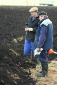 Graham Lark and Eric Hall discuss the progress of the raising of the Pymoor Bog Oak.