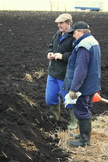 Graham Lark and Eric Hall discuss the progress of the raising of the Pymoor Bog Oak.