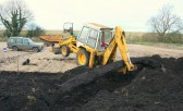 The Pymoor Bog Oak is very heavy and causes Richard Golding's JCB to tip up.
