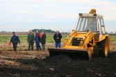 The ancient Pymoor Bog Oak removed, the 'management team' leave Richard Golding to fill in the hole!