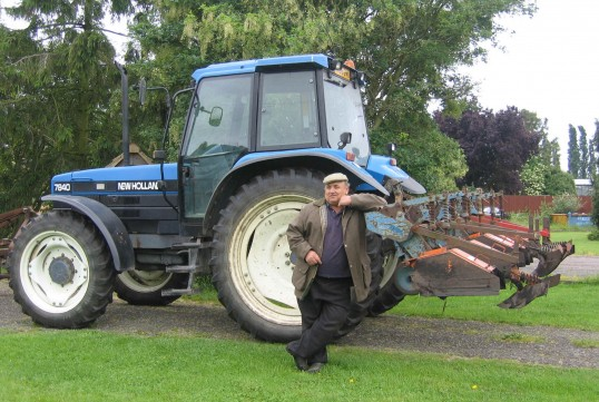 Baz Taylor by his tractor on the land outside the Methodist Chapel in Main Street, Pymoor, 2007.
