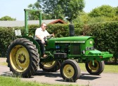 These vintage tractors come in all makes, sizes and colours. All lovingly cared for. Here another leaves the Pymoor Social Club 2007.