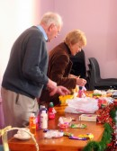 Cyril Heaps and Beryl Hodgkinson help to get the Tombola stall organised at the Pymoor Methodist Chapel Christmas Bazaar 2007.