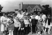 Children and Teachers outside their school in Pymoor.
