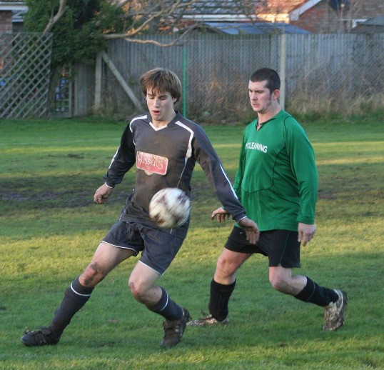 Ed Hale playing football for Pymoor FC against Lode on the recreation field in Pymoor. Pymoor won 7 - 1 with Ed scoring one of the goals. 2007