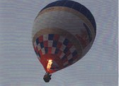 The balloonist attempts to gain height as he hovers close to the roof tops of the houses in Pymoor.