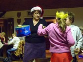 Jack and Lucy Ure help Christine Saberton draw out the tickets for the Raffle prizes at the Pymoor Social Club Christmas Bingo 2007.