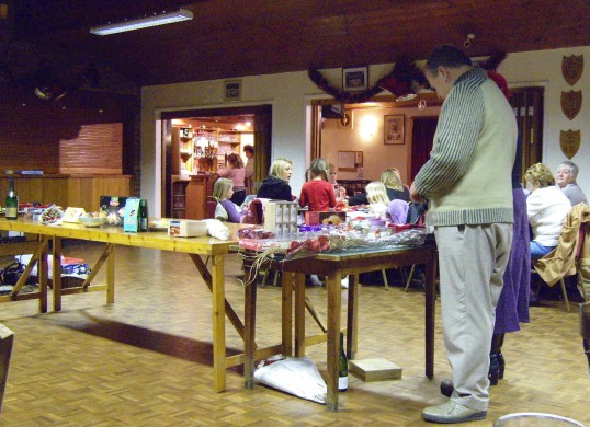 There are lots of prizes to be won at the Pymoor Social Club Christmas Bingo 2007. Winner, Neville Crick, is spoilt for choice.