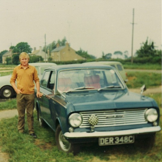 Tyrone Butcher standing by a car outside the Pymoor Methodist Church in Main Street.