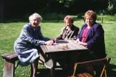 Pymoor ladies, Joan and Vera Saberton, with Alocha Barker,  enjoy the summer sunshine in an Ely garden, 1996.