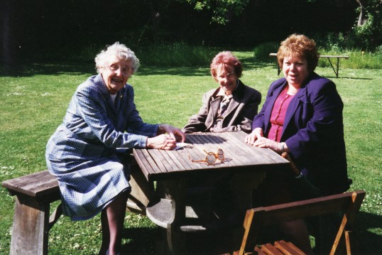 Pymoor ladies, Joan and Vera Saberton, with Alocha Barker,  enjoy the summer sunshine in an Ely garden, 1996.