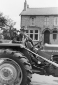 Tyrone Butcher driving a tractor in a Pymoor Carnival.