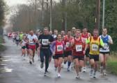 The Ely New Year's Eve Charity 10K Fun Run 2007 makes it's way down Pymoor Lane, Pymoor.