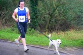 A dog and its owner enjoying the delights of Pymoor during the Ely New Year's 10K Charity Fun Run 2009.