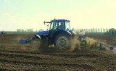 The dust flies as Tony Ruddenham works on Oxlode Farm, Pymoor. There was virtualy no rain this April and the ground is very dry.