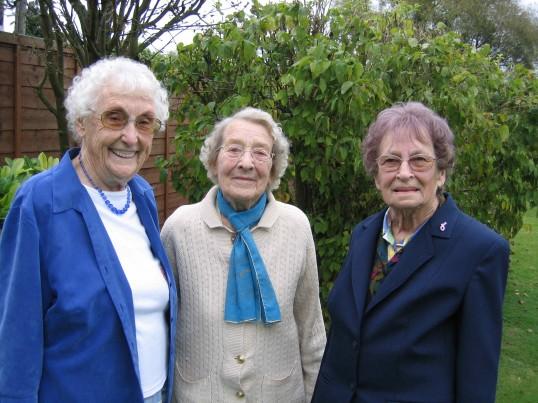 Joan and Vera Saberton with Ivy Rogers in Vera's garden in Pymoor.