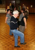 A group enjoy Line Dancing every Monday evening at the Pymoor Social Club, 2008.
