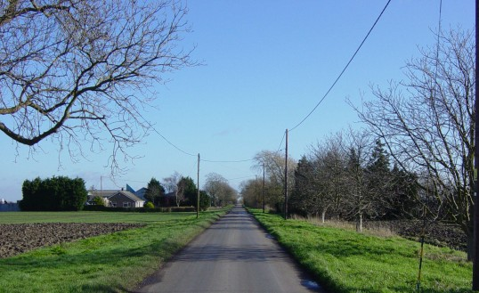 A view of Pymoor Lane, taken from the Old Mill, looking east. Lane Farm is on the left.
