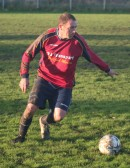 Pymoor FC Player/Manager Tony Ure in play against Wisbech St Mary at the Pymoor Sports Ground 2006. The pitch is very muddy.