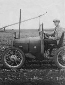 The Art of Adaptation. Walter Pearson with his converted car used as a plough on Sunnydale Farm, Oxlode, Pymoor.. A car converted to a mechanical hoe.