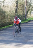 A cyclist in the Annual 25k Race 2008 comes along Pymoor Lane, Pymoor.