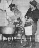 "Ida Sulman and Vera Saberton perform ""There's a hole in my bucket, dear Liza, dear Liza"" at the Pymoor WI Entertainment Evening.. Ida Sulman & Vera Saberton"