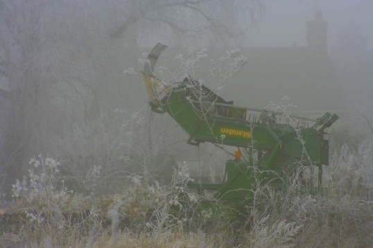 At times, it can be very cold and foggy in Pymoor. This old combine harvester is in an icy grip in a field off Pymoor Lane 2008.