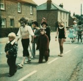Children walking along Main Street on there way to the Pymoor School Fete.
