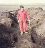 Jon Lark will never dig this enormous 7000 year old bog Oak out by hand from a field opposite First Drove, Pymoor, 1990.