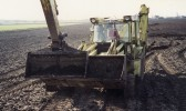 The only way to get the enormous Bog Oak off the field opposite First Drove, Pymoor, was for one digger to push the other one! 1990