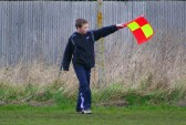 Jack Ure is a very good junior footballer, but here he is as linesman for the senior Pymoor football team at the Pymoor Sports Ground 2008.