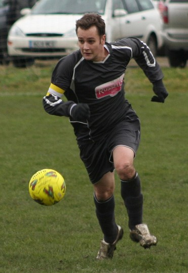 Pymoor FC Captain, Aaron Povey, leading his team to a 5 - 0 win over Needingworth United Res. at the Pymoor Sports Ground 2008.