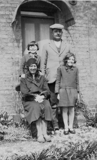 Clem and May Graham, with their daughters, Peggy and Freda, outside their home in Main Drove, Pymoor.