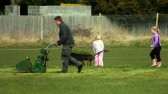 Summer seems a long way off as Shaun Butcher and his little helpers prepare the Pymoor cricket pitch for the coming season, 2008.