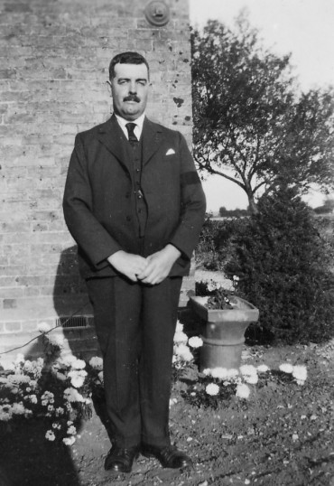 Clem Graham outside his house in Main Drove, Pymoor.