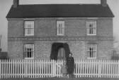 Freda Graham with Muriel Seekings outside a house in Black Bank, Pymoor.