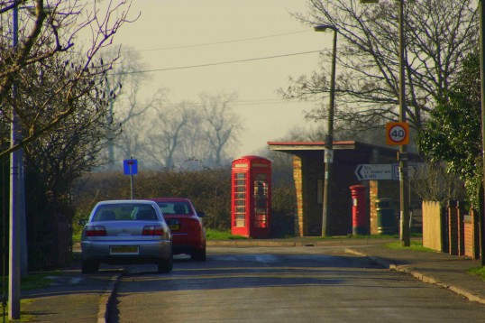 The Bus Shelter, Telephone Box and Post Box at the crossroads in Pymoor, viewed from Pymoor Lane.