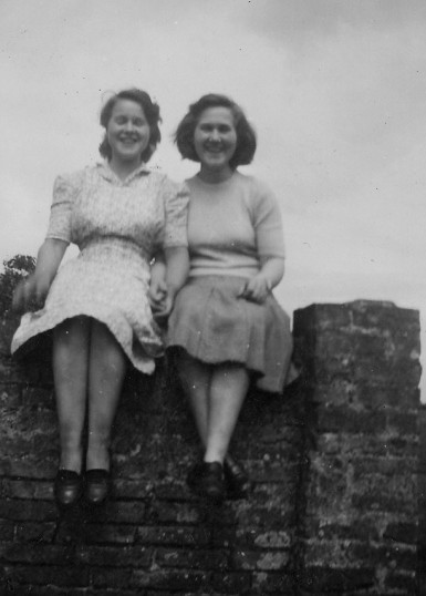 Jean and Betty Hannah sitting on a wall at Oxlode Manor, Pymoor.