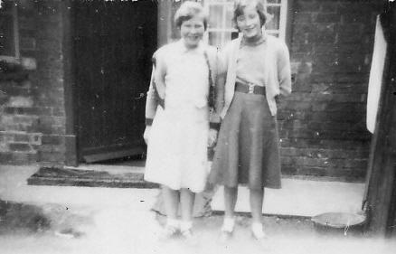 Sylvia Hannah and Joan Goodjohn standing near Saberton Stores in Main Street, Pymoor.