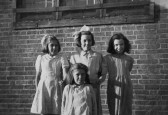 Heather (11), Dorothy (12), Sheal (10) and June (10), all members of the Girls Club, outside Pymoor School 1948.