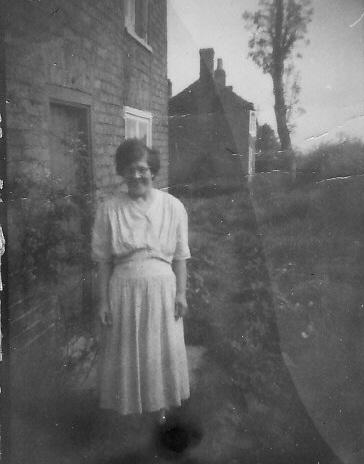 Eve Hannah, outside a cottage in Main Street, Pymoor, near Saberton's Stores.