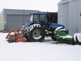 After a heavy fall of snow, there is no work today for this tractor at Laurel Farm, Main Drove, Pymoor.