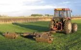 Tim Jordan rolling a field in Pymoor.