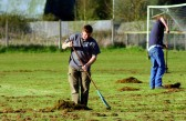 Clearing the outfield of grass cuttings ready for the coming cricket season in Pymoor, 2008.