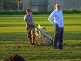 Ed Hale drags a bag full of grass cuttings across the Pymoor Cricket Club outfield, 2008.