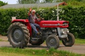 A vintage tractor leaves the Pymoor Cricket Club, Pymoor Lane, Pymoor 2008.