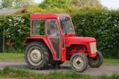 The last of the vintage tractors leaves the Pymoor Cricket Club, Pymoor Lane, Pymoor 2008.